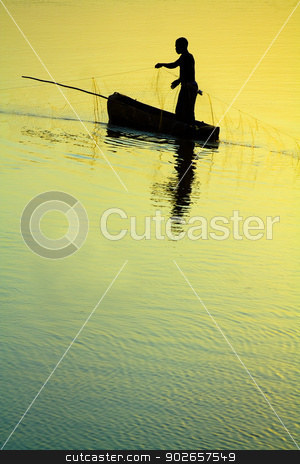 Traditional Fisherman Sillhouette stock photo, Dramatic sunset of a Traditional Fisherman Sillhouette by Donovan van Staden