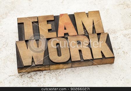 teamwork word in wood type stock photo, teamwork word in vintage letterpress wood type on a ceramic tile background by Marek Uliasz
