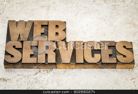 web services text  in wood type stock photo, web services text  in vintage letterpress wood type on a ceramic tile background by Marek Uliasz