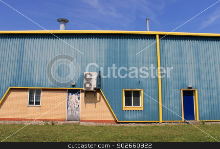 Blue and yellow warehouse stock photo, Exterior of blue and yellow warehouse building with air conditioning. by Martin Crowdy