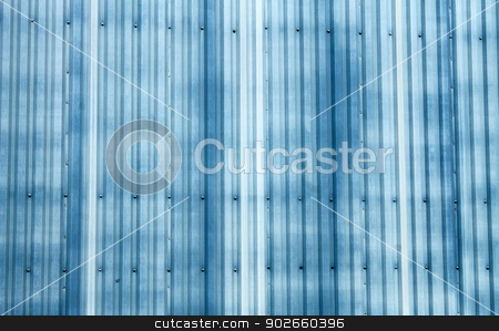 Blue corrugated metal background stock photo, Abstract background of blue corrugated metal on warehouse building. by Martin Crowdy