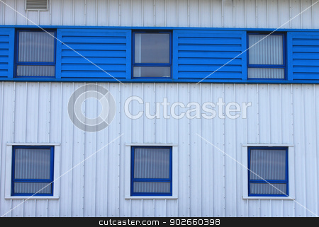 Modern office building stock photo, Exterior of modern office building with blue windows. by Martin Crowdy