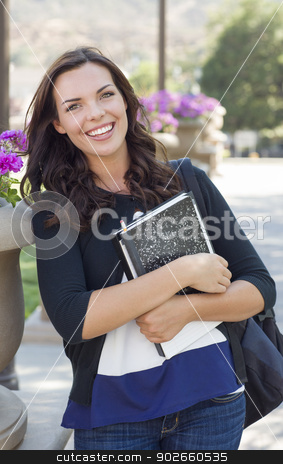 Pretty Young Female Student Portrait on Campus stock photo, Portrait  of Pretty Young Female Student Carrying Books on School Campus. by Andy Dean