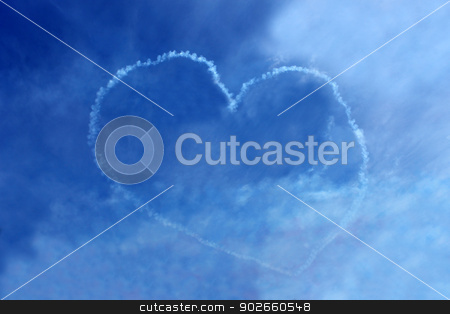 Love heart in blue sky stock photo, Vapor trail love heart in blue sky seen suring air display. by Martin Crowdy