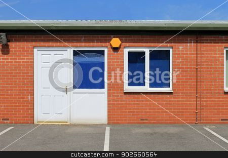 Modern office building stock photo, Exterior of modern office building with security alaram. by Martin Crowdy