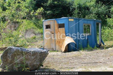 Old cabin in countryside stock photo, Exterior of old workman cabin in countryside with green background. by Martin Crowdy