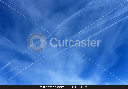 Vapor trails in blue sky stock photo, Scenic view of white vapor trails in blue sky. by Martin Crowdy