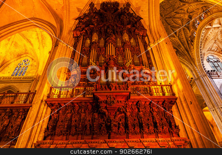 Organ Arches Stained Glass Statues Cathedral of Saint Mary of th stock photo, Organ Arches Stained Glass Statues Seville Cathedral, Cathedral of Saint Mary of the See, Seville, Andalusia Spain.  Built in the 1500s.  Largest Gothic Cathedral in the World and Third Largest Church in the World.  Burial Place of Christopher Columbus. by William Perry