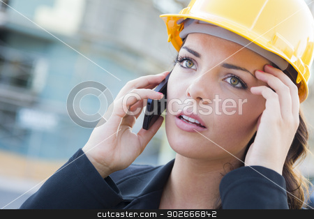 Worried Female Contractor Wearing Hard Hat on Site Using Phone stock photo, Young Worried Looking Professional Female Contractor Wearing Hard Hat at Construction Site Using Cell Phone. by Andy Dean
