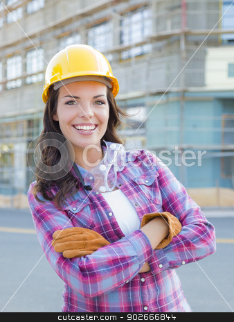 Young Attractive Female Construction Worker Wearing Hard Hat and stock photo, Portrait of Young Attractive Female Construction Worker Wearing Gloves, Hard Hat and Protective Goggles at Construction Site. by Andy Dean