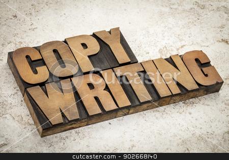 copywriting  word in wood type stock photo, copywriting  word in vintage letterpress wood type on a ceramic tile background by Marek Uliasz