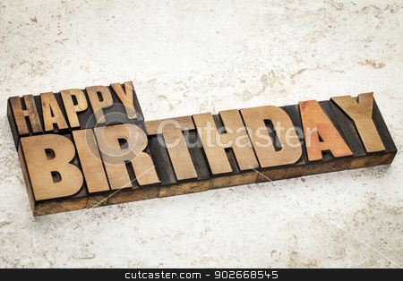 happy birthday in wood type stock photo, happy birthday text  in vintage letterpress wood type on a ceramic tile background by Marek Uliasz