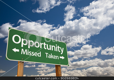 Opportunity Missed and Taken Green Road Sign and Clouds stock photo, Opportunity Missed and Taken Green Road Sign Over Dramatic Blue Sky and Clouds. by Andy Dean