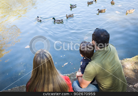 Mixed Race Mother and Father with Son at the Pond stock photo, Mixed Race Mother and Father with Son at the Park Duck Pond. by Andy Dean