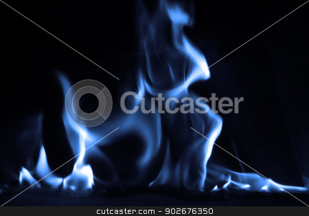 Blue flame stock photo, Blue flame isolated on dark background by Nneirda