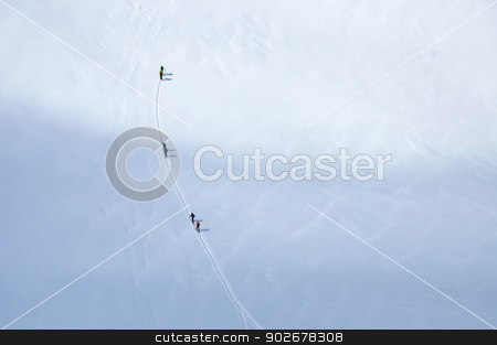 Skiers on the glacier in Alps stock photo, A group of skiers wandering across a glacier in Austrian Alps by Krzysztof Nahlik