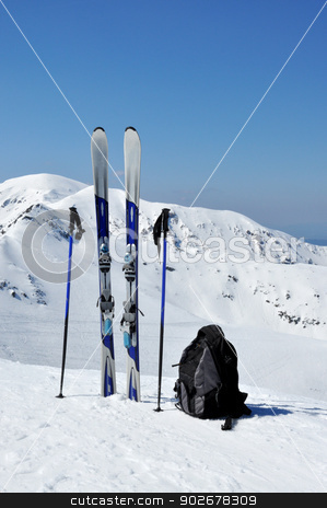 Skis, ski poles and backpack in Tatra mountains stock photo, A pair of skis, ski poles and a backpack in Tatra mountains in Poland. by Krzysztof Nahlik