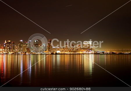San Diego Skyline Night stock photo, The skyline of San Diego at night with reflection in the water. by Henrik Lehnerer