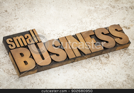 small business in wood type stock photo, small business text  in vintage letterpress wood type on a ceramic tile background by Marek Uliasz