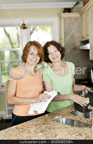 Two women doing dishes in kitchen stock photo, Mother and daughter doing dishes in kitchen at home by Elena Elisseeva