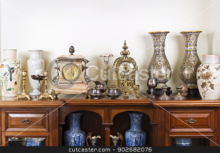 Antique vases and clocks stock photo, Various antique clocks vases and candlesticks on display by Elena Elisseeva