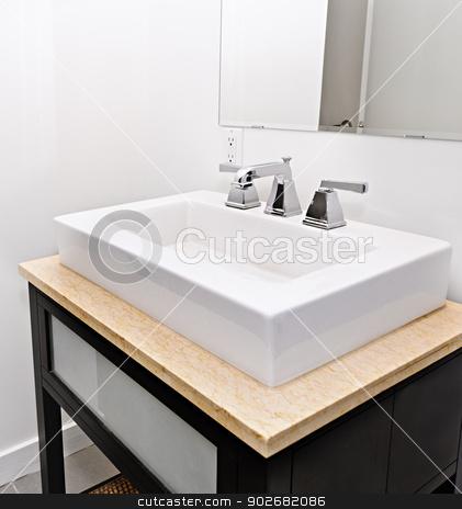 Bathroom sink stock photo, Closeup interior of bathroom vanity and mirror by Elena Elisseeva