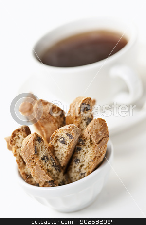 Biscotti cookies and coffee stock photo, Italian biscotti in a bowl with cup of black coffee on white background by Elena Elisseeva