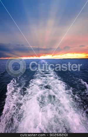 Sunset over ocean with boat wake stock photo, Wake of boat at beautiful sunset on horizon. Georgian Bay, Canada. by Elena Elisseeva