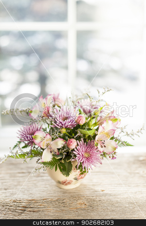 Flower arrangement stock photo, Bouquet of colorful flowers arranged in small vase by Elena Elisseeva