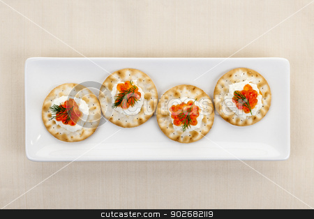 Caviar appetizers stock photo, Caviar appetizer with goat cheese and crackers on white plate from above by Elena Elisseeva