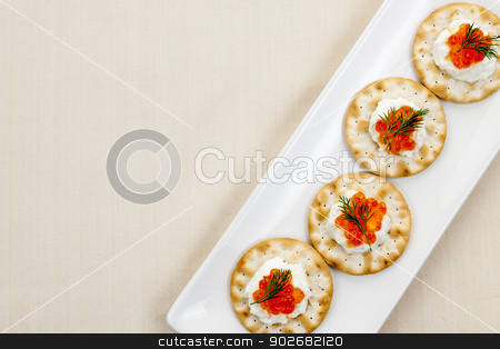 Caviar appetizers stock photo, Caviar and goat cheese appetizer on white plate from above with copy space by Elena Elisseeva