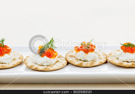 Caviar appetizers stock photo, Caviar appetizer with goat cheese and crackers on white plate by Elena Elisseeva