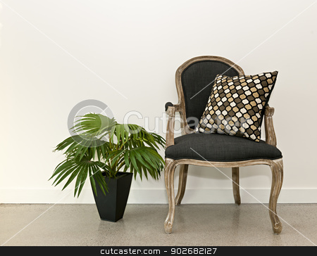 Antique armchair and plant near wall stock photo, Antique armchair furniture with houseplant against white wall, interior design concept by Elena Elisseeva