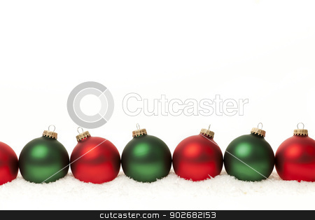 Border of green and red Christmas balls stock photo, Row of green and red Christmas ornaments on white background by Elena Elisseeva