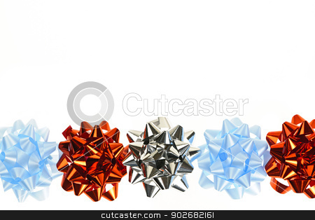 Gift wrapping bows border stock photo, Row of multicolored gift wrapping bows isolated on white background by Elena Elisseeva