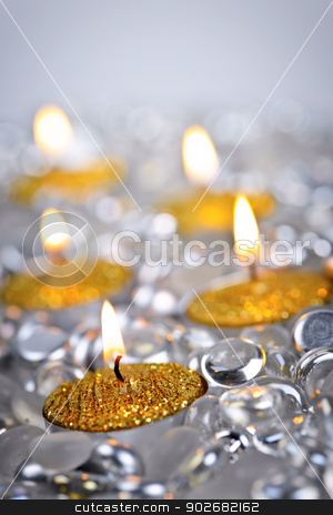 Gold Christmas candles stock photo, Burning golden decorative Christmas candles with glass beads by Elena Elisseeva