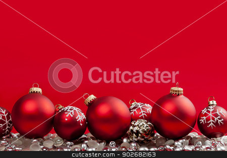 Red Christmas background with ornaments stock photo, Red and silver Christmas decorations on crimson background by Elena Elisseeva