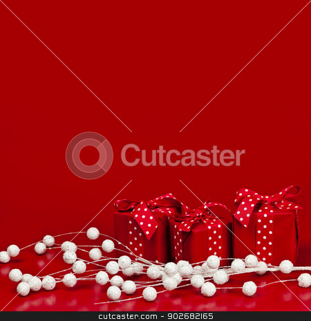 Red Christmas background with gift boxes stock photo, Red Christmas background with wrapped presents and decorations by Elena Elisseeva
