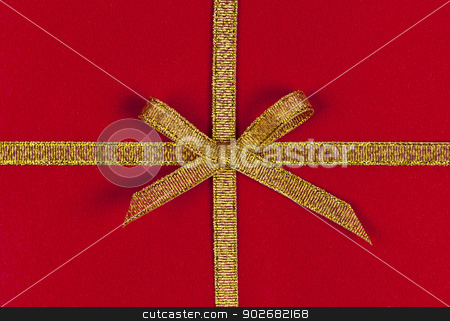 Red gift with gold ribbon stock photo, Red present wrapped with gold ribbon and bow by Elena Elisseeva