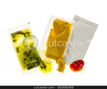 Condiment packets stock photo, Relish mustard and ketchup condiment packets open on white background by Elena Elisseeva
