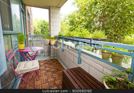 Apartment balcony stock photo, Balcony of condo with patio furniture and plants by Elena Elisseeva