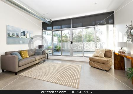 Modern living room and balcony stock photo, Living room with sliding glass door to balcony - artwork from photographer portfolio by Elena Elisseeva