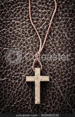 Christian Cross on Bible stock photo, Closeup of simple wooden Christian cross necklace on leather bound holy Bible by Elena Elisseeva