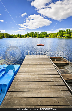 Dock on lake in summer cottage country stock photo, Wooden dock on beautiful summer lake in Ontario Canada by Elena Elisseeva
