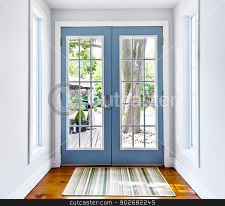 French patio glass door stock photo, Double patio french doors with windows exiting to sunny backyard by Elena Elisseeva