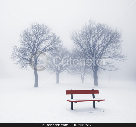 Winter trees and bench in fog stock photo, Foggy winter scene with leafless trees and red park bench by Elena Elisseeva