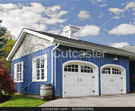 Two car garage stock photo, Double car garage with white doors and blue exterior by Elena Elisseeva