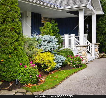 Garden and home entrance stock photo, Front entrance of house with garden and porch by Elena Elisseeva