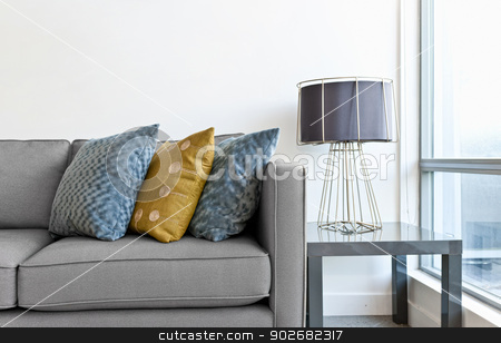 Interior design detail stock photo, Interior design with couch, colorful cushions and lamp on end table by Elena Elisseeva
