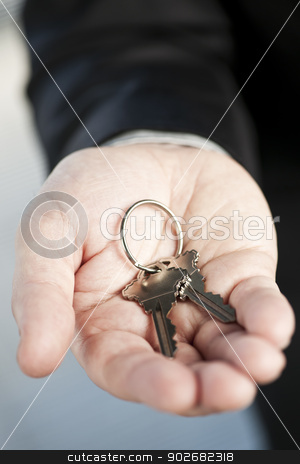 Hand offering new keys stock photo, Male hand offering two new house keys on key ring by Elena Elisseeva